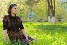 Free Young Beautiful Woman Sitting On The Grass Royalty Free Stock Images - 5888149