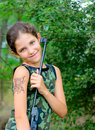 Free Girl With Gun In Wood Stock Image - 5895091