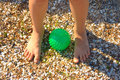 Free Child Legs On Sand With Green Ball Stock Image - 5897321