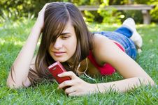 Free Young Woman Using Her Phone Royalty Free Stock Photo - 5891795