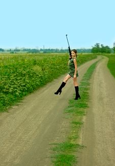 Free Girl With Gun On Road Stock Photo - 5895160