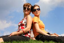 Friends Sitting On The Grass Stock Photography