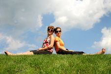 Friends Sitting On The Grass Royalty Free Stock Image