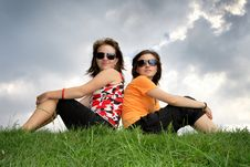 Friends Sitting On The Grass Royalty Free Stock Photos