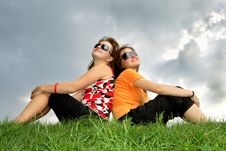 Friends Sitting On The Grass Stock Photos