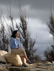 Sitting On A Stone Stock Photography