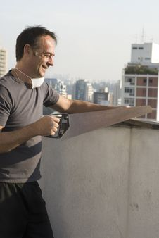 Free Smiling Man Using Handsaw - Vertical Stock Image - 5899391