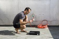 Man Looking At Paintbrush - Horizontal Royalty Free Stock Photography