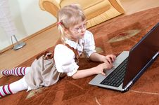 Free Little Girl With Laptop Royalty Free Stock Image - 592396