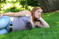 Free Girl Laying On Grass Royalty Free Stock Photography - 5901947