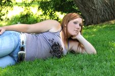 Girl Laying On Grass Royalty Free Stock Photography