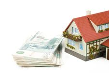 Miniature House And Money. Royalty Free Stock Images