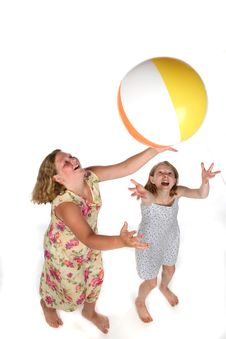 Free Two Girls Tossing Ball In Air Royalty Free Stock Photography - 5902867