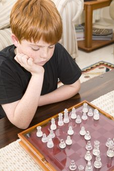 Free Red Head Boy Playing Chess Stock Photos - 5912903