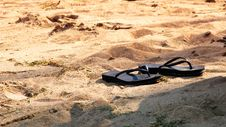 Free Slippers In Sand Royalty Free Stock Photography - 5919707