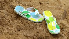 Free Flip Flops In The Sand Stock Photography - 5919812