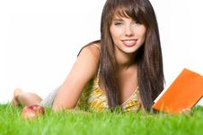 Free Girl Reading Book In The Grass Royalty Free Stock Photography - 5920037