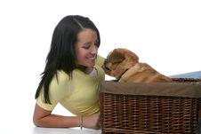 Free Cute Teen Leaning Toward Little Dog In Basket Stock Photo - 5920450