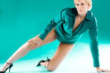 Blond Girl In Green Blouse Stretching Her Leg Royalty Free Stock Images