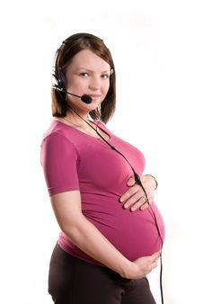 Free Pregnant Woman Wearing Earphones With A Microphone Royalty Free Stock Photos - 5922428