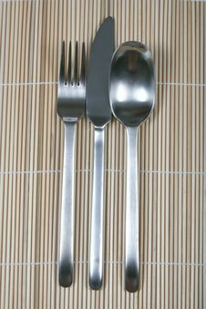 Free Fork Knife And Spoon On Bamboo Stock Images - 5922924
