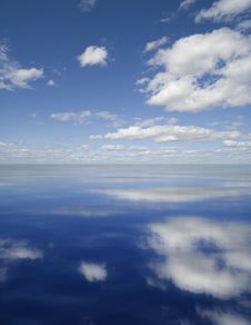 Free Clouds Reflected In Water Royalty Free Stock Photography - 5924437