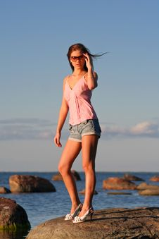Young Girl Standing Near The Sea Royalty Free Stock Photo