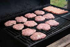 Grilling Hamburgers And Hotdogs Royalty Free Stock Images