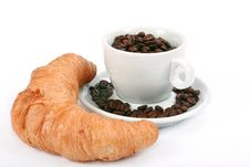 Croissant And Cup With Coffee Beans Royalty Free Stock Images