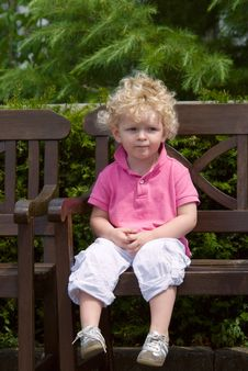 Free Boy Sitting On A Bench Stock Photos - 5929653