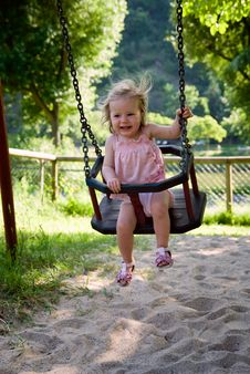Girl Having Fun On A Swing Stock Images