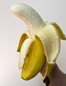Free Held Banana On White Royalty Free Stock Photos - 5932508