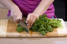 Free Woman Chopping Food In Kitchen Stock Images - 5932884