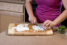 Free Woman Chopping Onions In Kitchen 1 Stock Photos - 5932973