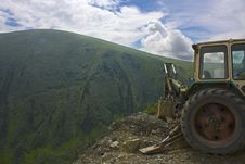 Free Tractor In Mountains Stock Photography - 5933322