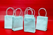 Gift Bags Over Red Stock Image