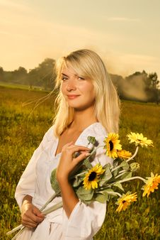 Free Woman With A Sunflowers Stock Photography - 5937402