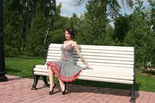 Free Girl Sits On A Bench Stock Photography - 5937652