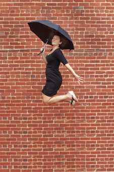 Free Umbrella Jump! Stock Photo - 5938280