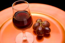 Red Wine And Grapes On A Tray
