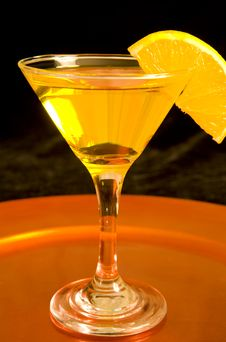Yellow Cocktail On Bronze Tray Stock Image