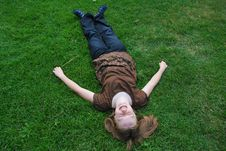 Free Girl Laying On Grass Royalty Free Stock Images - 5955049