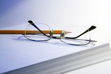 Free Spectacles, Pencil And Paper Stock Image - 5955051