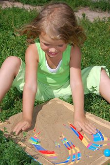 Free Pretty Girl Playing With Sand Royalty Free Stock Photos - 5955388