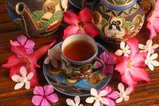 Tea Set With Tea And Flowers Stock Image