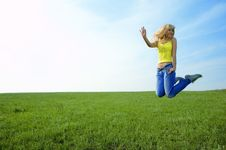 Free Happy Beauty Young Woman Jump In Field Royalty Free Stock Photography - 5958017