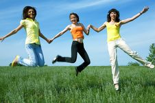 Free Three Girlfriend Jump In Green Field Stock Image - 5958181