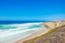 Free Beautiful Beach In Portugal With Cliff And Blue Sky Stock Image - 59504221