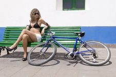 Sexy Woman With A Bike Sitting Stock Images