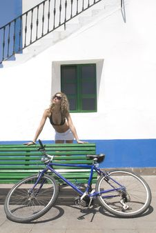 Sexy Woman With A Bike And Short Relaxing Stock Photo